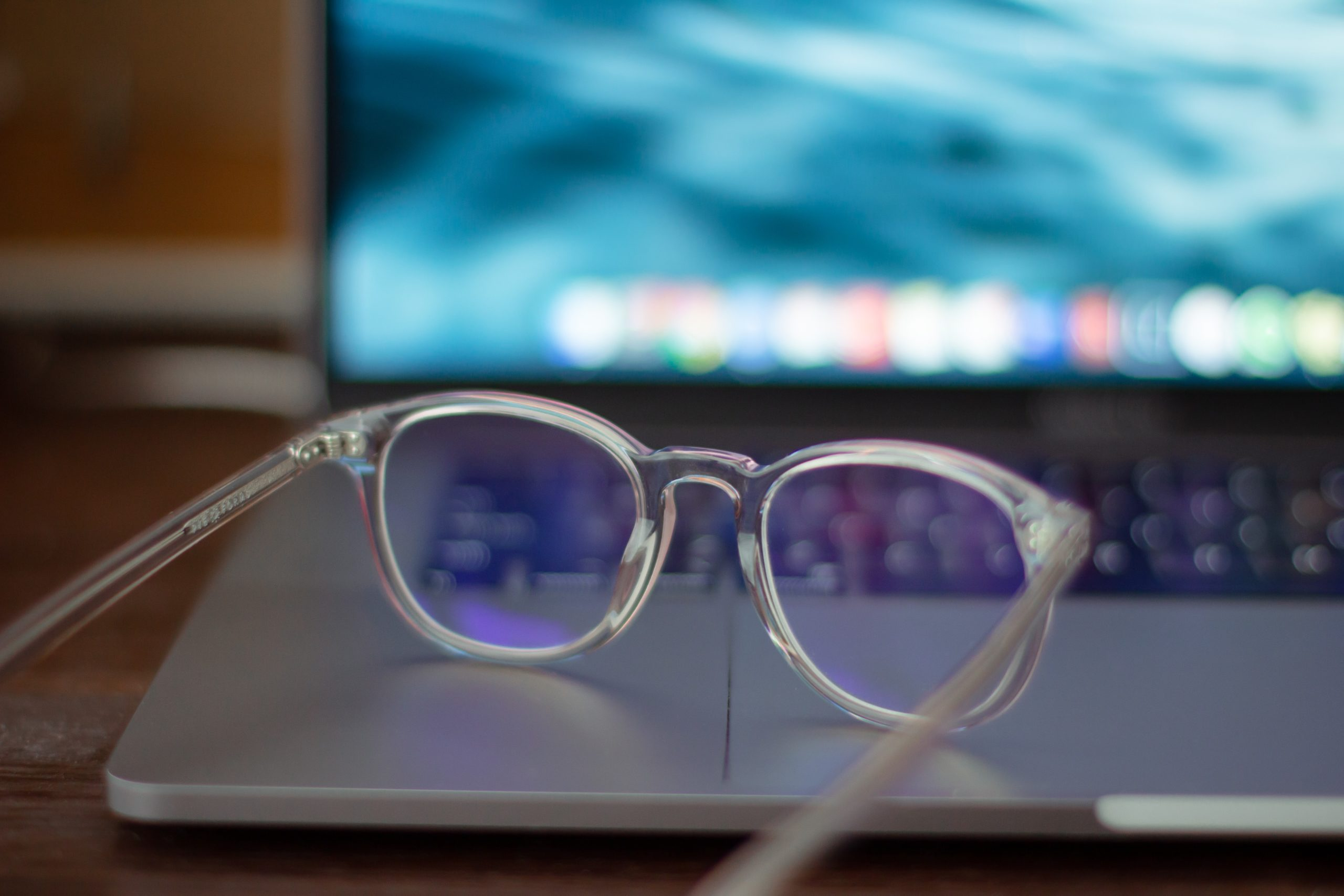 silver framed eyeglasses on a laptop representing hiring an expert for any new project
