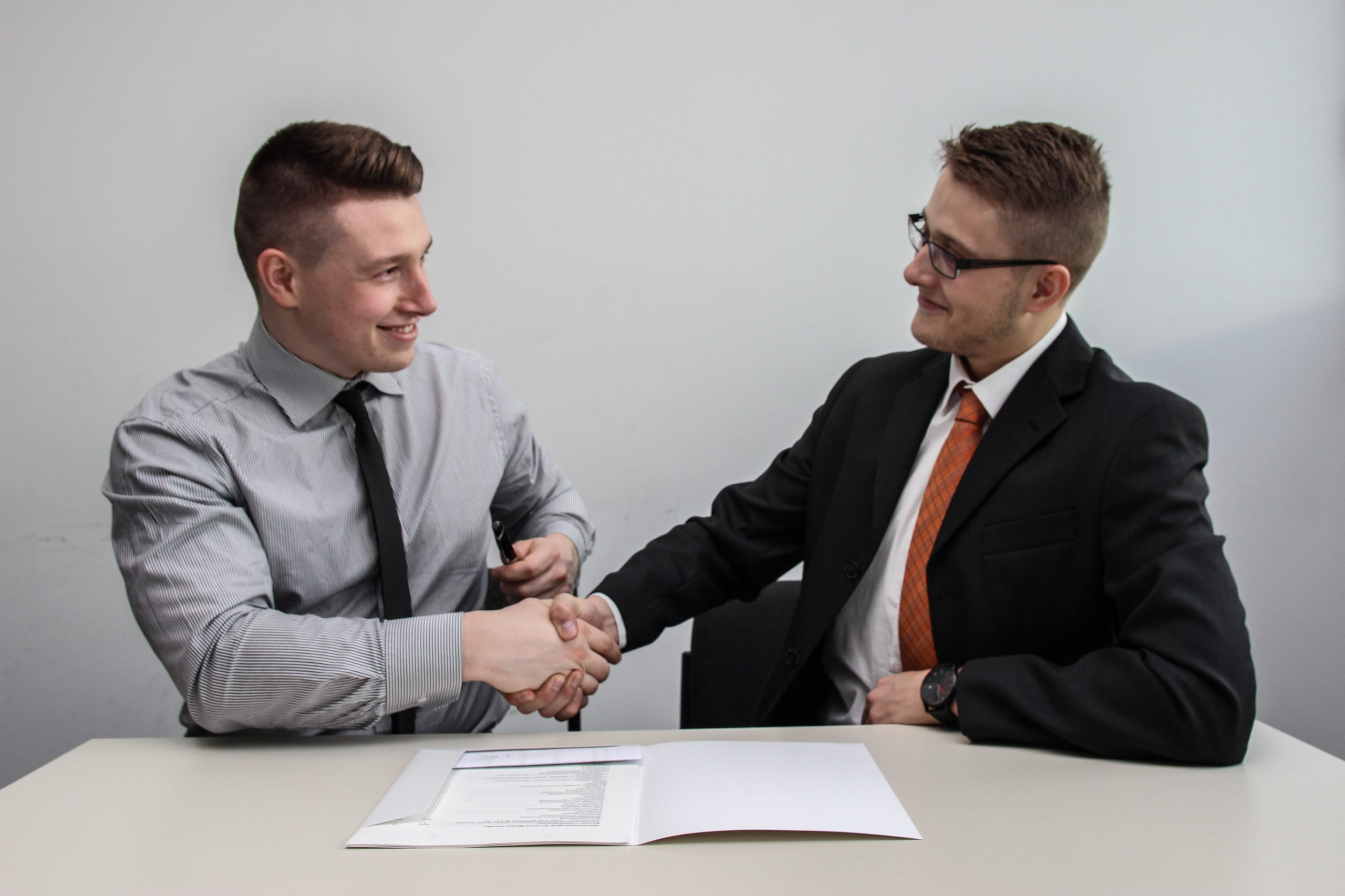 amazon business owner shaking hands cordially with a client