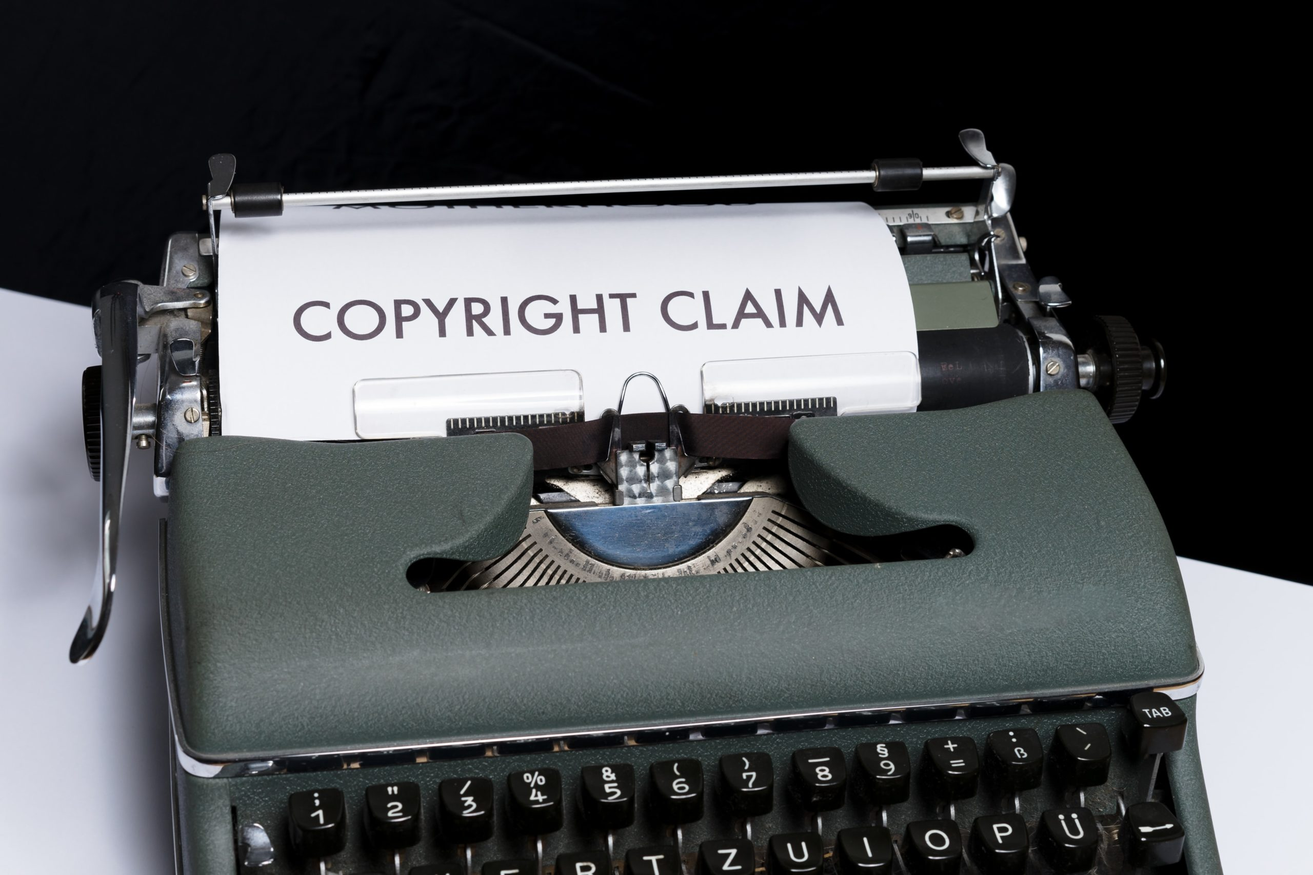"""Copyright Claim"" reads the paper inside the paper feed of the typewriter which copyright claim is included in the freelance contract"