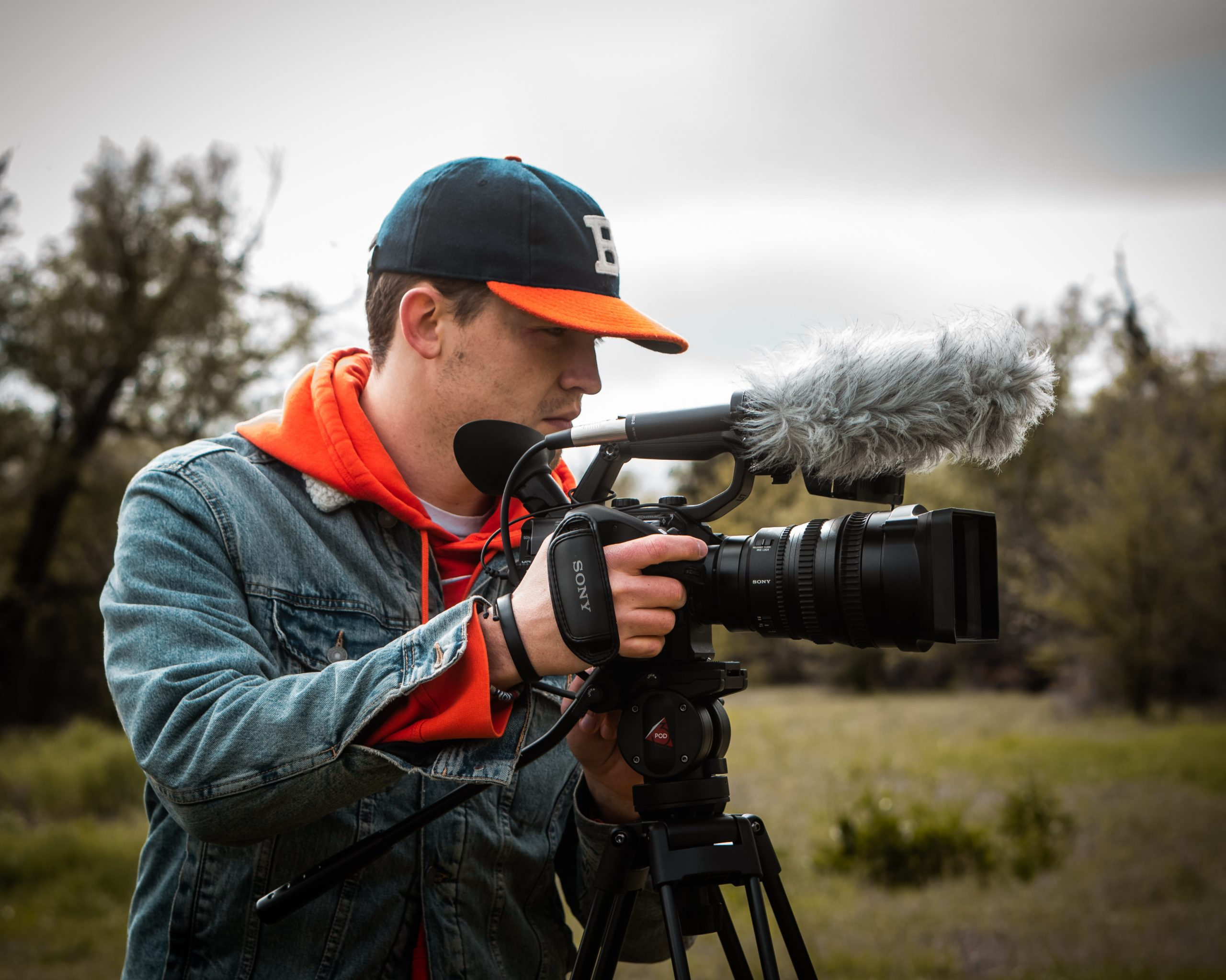 A freelance videographer making a video using his video camera