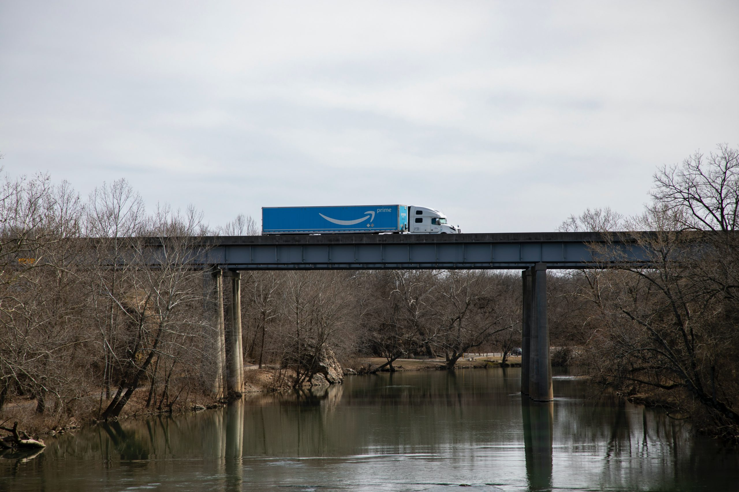 Delivery truck of Amazon passing on a bridge