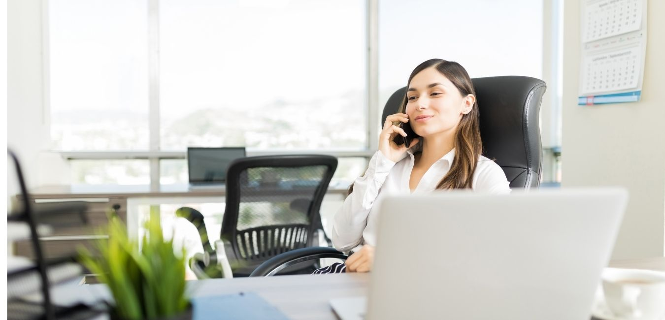female real estate virtual assistant talking on phone