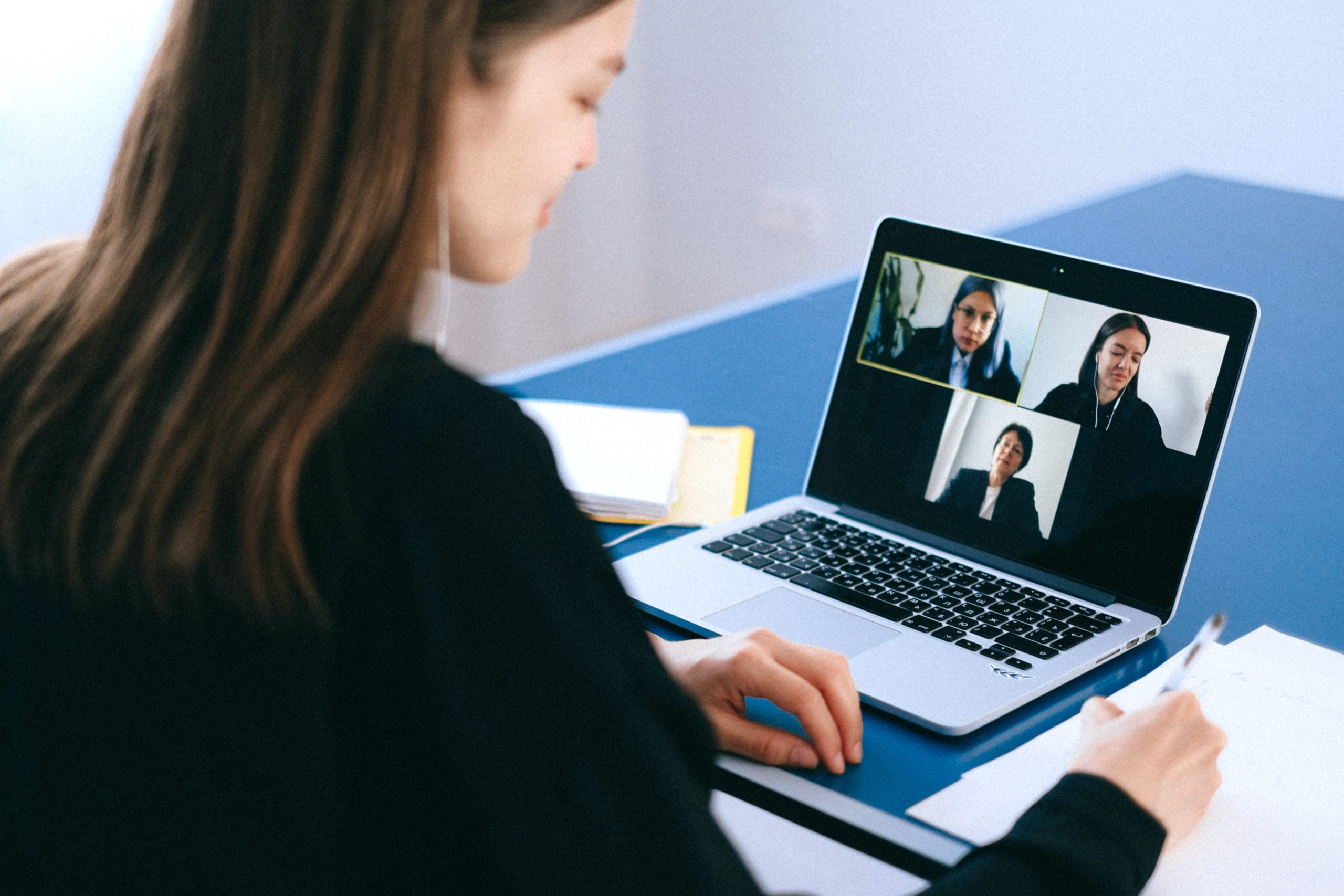 woman using laptop for virtual meeting