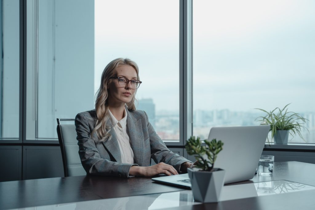 woman in business attire for virtual meeting